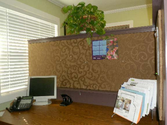 Every  workspace has privacy walls around it so agents can concentrate and talk on their phones easily. Sound  absorbing boards are covered in beautiful fabrics and function as bulletin boards.